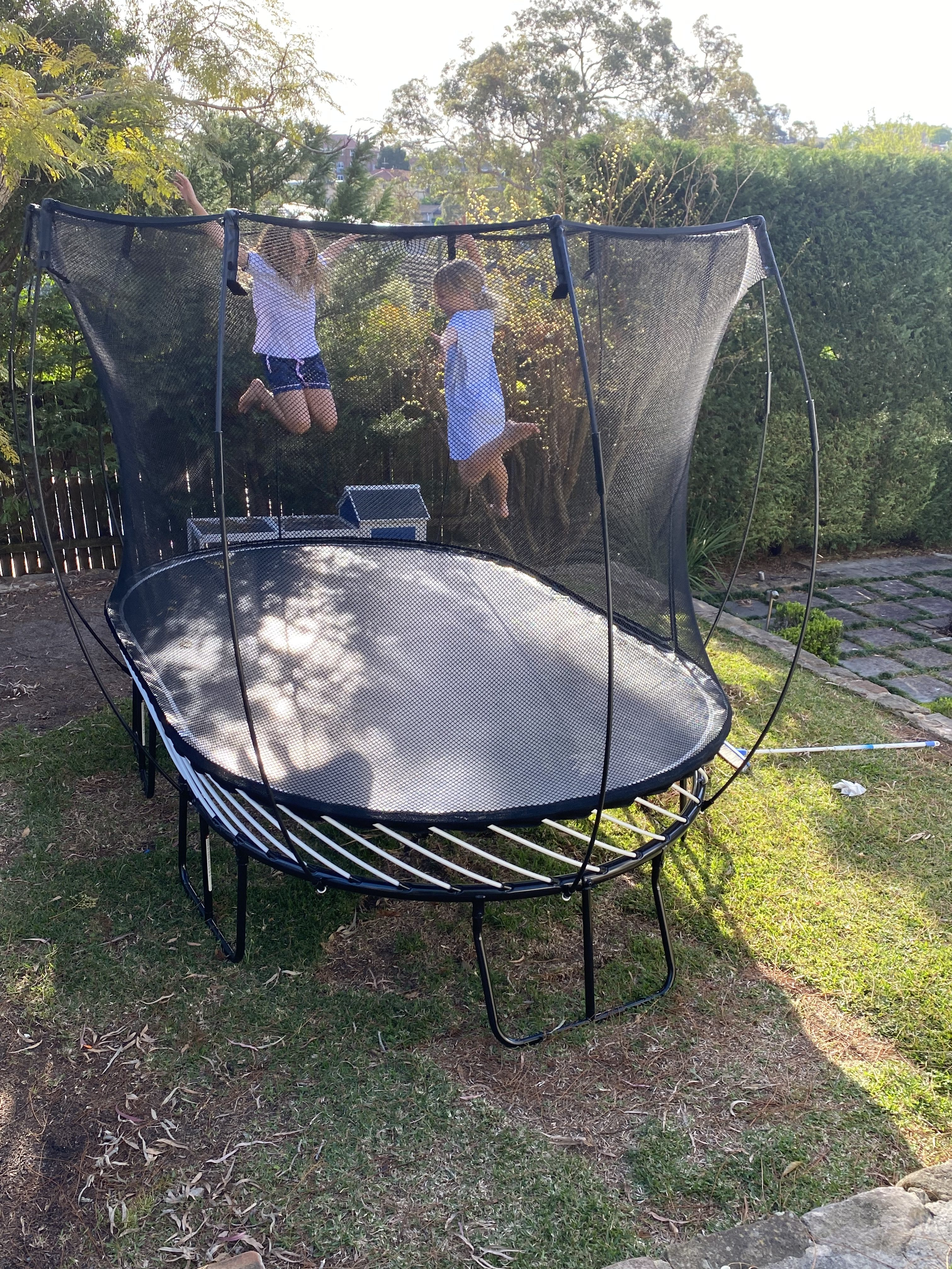 David's two girls jump high on their trampoline